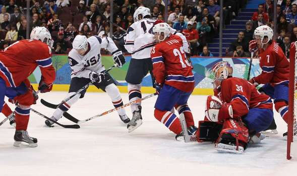 VANCOUVER, BC - FEBRUARY 18:  Jamie Langenbrunner of The United States takes a shot on the Norway goal during the ice hockey men's preliminary game between USA and Norway on day 7 of the 2010 Winter Olympics at Canada Hockey Place on February 18, 2010 in Vancouver, Canada.  (Photo by Bruce Bennett/Getty Images) *** Local Caption *** Jamie Langenbrunner Photo: Bruce Bennett, Getty Images / 2010 Getty Images