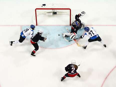 VANCOUVER, BC - FEBRUARY 18:  Jessie Vetter of The United States makes a save during the ice hockey women's preliminary game between USA and Finland on day 7 of the 2010 Vancouver Winter Olympics at UBC Thunderbird Arena on February 18, 2010 in Vancouver, Canada.  (Photo by Harry How/Getty Images) *** Local Caption *** Jessie Vetter Photo: Harry How, Getty Images / 2010 Getty Images