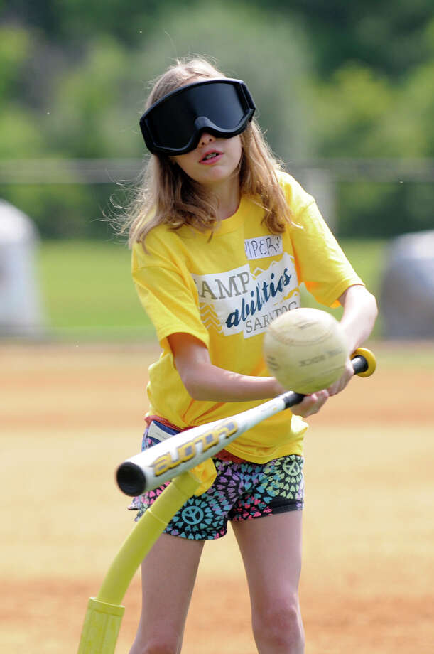 Piper Rolfe hits the ball during an inning of beep baseball at Camp Abilities for blind youth at Skidmore College on Friday, August 8, 2014 in Saratoga Springs, N.Y.  After the batter hits the ball, a beeping sound is activated to alert the infielders.  (Tom Brenner/ Special to the Times Union) Photo: Tom Brenner / ©Tom Brenner/ Albany Times Union