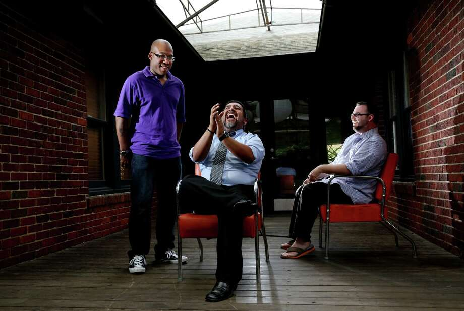 Jonathan Moody, from left, Lupe Mendez and Stephen Gros are gearing up for the Word Around Town Poetry Tour. Photo: Gary Coronado, Staff / © 2014 Houston Chronicle
