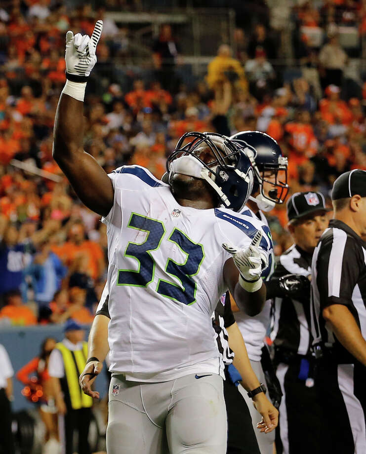 Seattle Seahawks running back Christine Michael (33) points upward after scoring a touchdown against the Denver Broncos during the first half of an NFL preseason football game, Thursday, Aug. 7, 2014, in Denver. (AP Photo/Jack Dempsey) Photo: Jack Dempsey, FRE / FR42408 AP