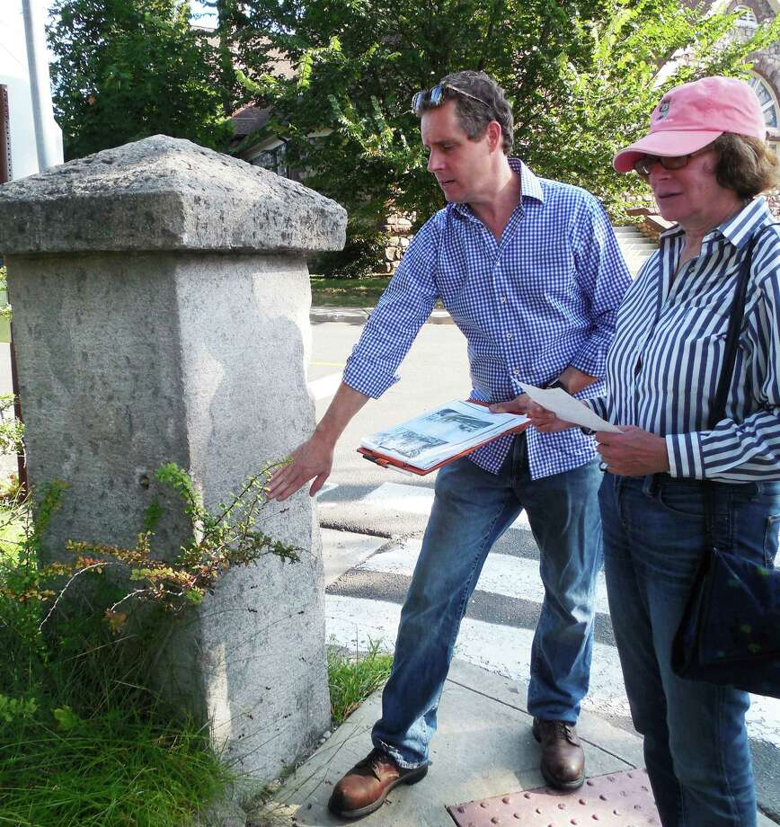 Morley Boyd, (left) a member of the Downtown Steering Committee and former chair of the Historic District Commission, and Selectman Helen Garten, who chairs the Kemper-Gunn Advisory Group, check out the granite marker Boyd would like to see turned in to a memorial for pioneer woman journalist Sigrid Lillian Schultz, who lived on Elm Street until her death in 1980. Photo: Anne M. Amato / westport news