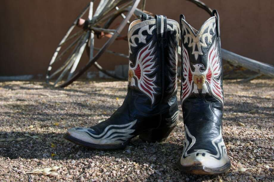 "A custom pair of Nudie cowboy boots emblazoned with a white ""H"" for their original owner, Hank Williams Sr. will be on auciton. Photo: Guernsey's"