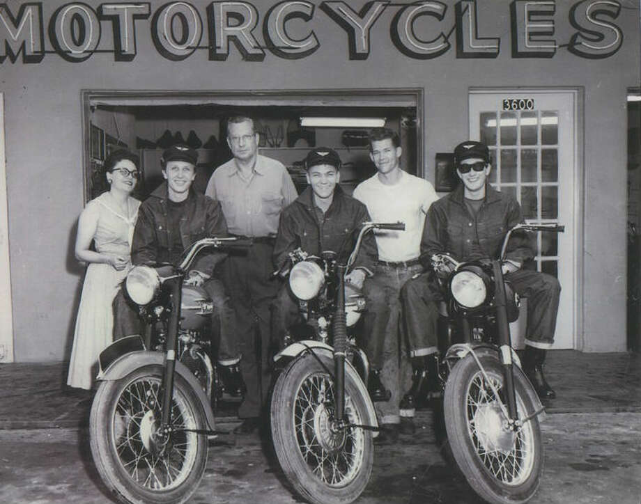 Holly, far right, is pictured on the motorcycle. Photo: Guernsey's