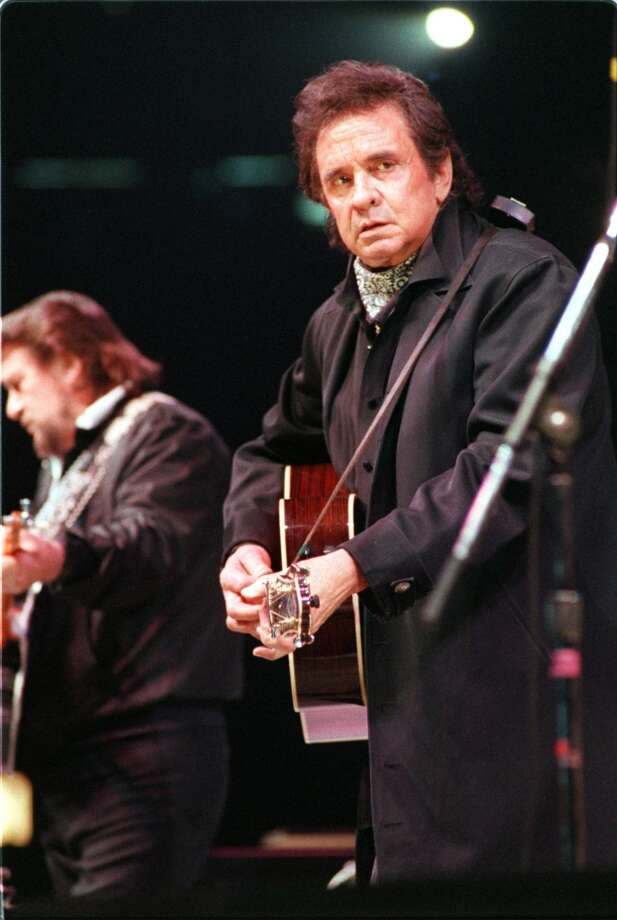 Johnny Cash (Right) and Waylon Jennings (Left) two of The Highwaymen performing at the Houston Rodeo, March 3, 1990. Photo: Paul Howell, © Houston Chronicle