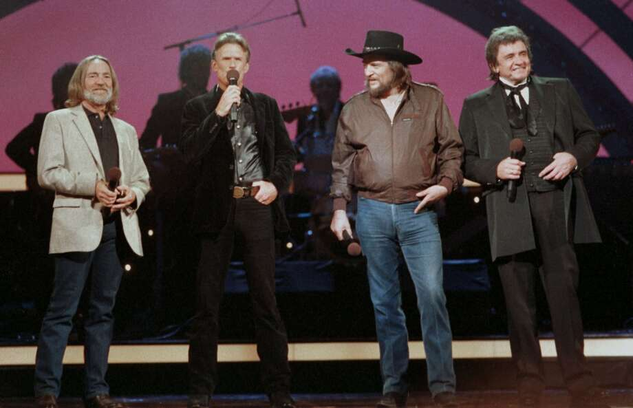 Country music legend Johnny Cash, right, performs in October 1985 with Willie Nelson, left, Kris Kristofferson, second from left, and Waylon Jennings, second from right, in Nashville, Tenn. Photo: MARK HUMPHREY, AP