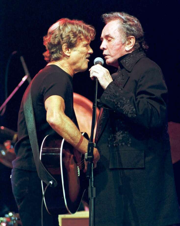 Kris Kristofferson, left, and Johhny Cash sing 'Sunday Morning Coming Down,' a song written by Kristofferson which became a hit for Cash in 1970, during a tribute concert celebrating the music of Cash and Waylon Jennings Wednesday, June 24, 1998, at the Ryman Auditorium in Nashville, Tenn. Photo: CHRISTOPHER BERKEY, AP