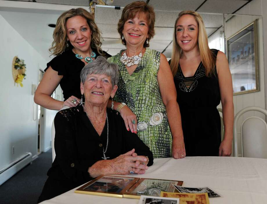 Zita Carrano, who started teaching dance at 16-years-old at a church in Bridgeport, is surrounded by her daughter and granddaughters who followed in her graceful footsteps and took over the family business. Julie Arcos and her mom Nancy Altieri, are codirects at Kicks Dance Center in Shelton where Christina Altieri, far right, also teaches. Photo: Autumn Driscoll / Connecticut Post