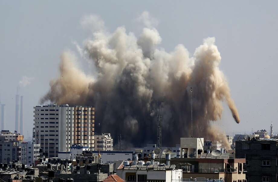 Smoke, dust and debris rise over Gaza City after an Israeli strike. Israel retaliated after Gaza militants resumed rocket attacks on the country, shattering a brief cease-fire. Five Palestinians were killed. Photo: Hatem Moussa, Associated Press