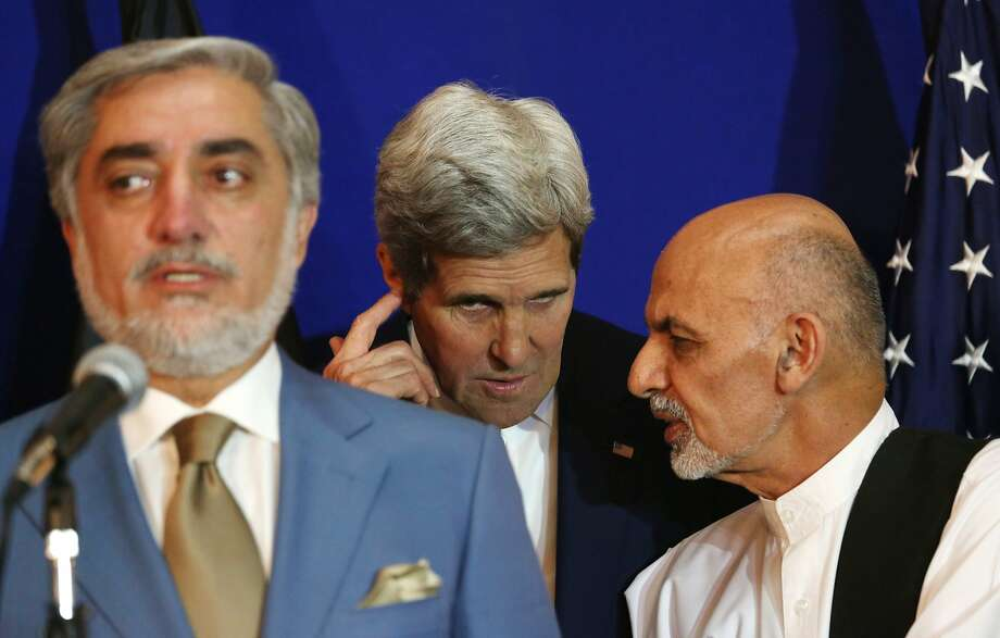 Afghan presidential candidates Abdullah Abdullah (left) and Ashraf Ghani Ahmadzai (right) agreed to a deal with U.S. Secretary of State John Kerry. Photo: Rahmat Gul, Associated Press