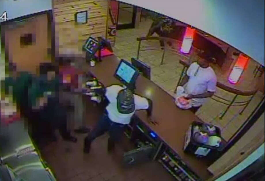 POPEYE'S CHICKEN ROBBERY: Harris County deputies are looking for three suspects who robbed at gunpoint a Popeye's Louisiana Kitchen located on West FM 1960 on July 27, 2014. Once an employee opened the restaurant safe, one of the suspects pulled out a gun, hopped over the counter and took money from both the safe and the cash register.SEE THE VIDEO: Gunmen stick up chicken restaurant Photo: Crime Stoppers Of Houston
