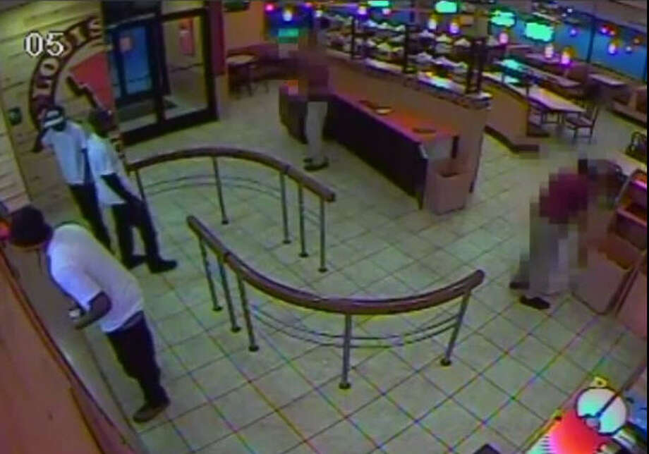 Harris County deputies are looking for three suspects who robbed at gunpoint a Popeye's Louisiana Kitchen located on West FM 1960 on July 27, 2014. According to deputies, the three men entered the store, placed an order and attempted to pay with a large bill. Once an employee opened the restaurant safe, one of the suspects pulled out a gun, hopped over the counter and took money from both the safe and the cash register. | Crime Stoppers of Houston Photo: Crime Stoppers Of Houston