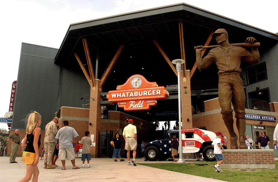 "PHOTOS: A look at Corpus Christi's Whataburger Field after Hurricane HarveyFans arrive at Whataburger Field in Corpus Christi for a Texas League game between the hometown Hooks and the Frisco Roughriders on Thursday, July 28, 2005. The bronze statue, ""For the Love of the Game,"" by artist Seth Vandable, graces the entrance. The Hooks are the AA affiliate of the Houston Astros. BILLY CALZADA / STAFFBrowse through the photos above for a look at Corpus Christi's Whataburger Field after Hurricane Harvey. Photo: BILLY CALZADA, SAN ANTONIO EXPRESS-NEWS / SAN ANTONIO EXPRESS-NEWS"