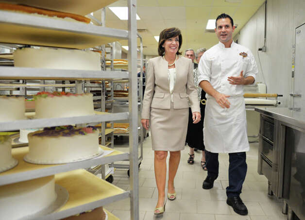 Lieutenant governor candidate Kathy Hochul, left, tours the Villa Italia Bakery with owner Bobby Mallozzi during a campaign stop Friday August 8, 2014, in Schenectady, NY.  (John Carl D'Annibale / Times Union) Photo: John Carl D'Annibale, Albany Times Union / 00028100A
