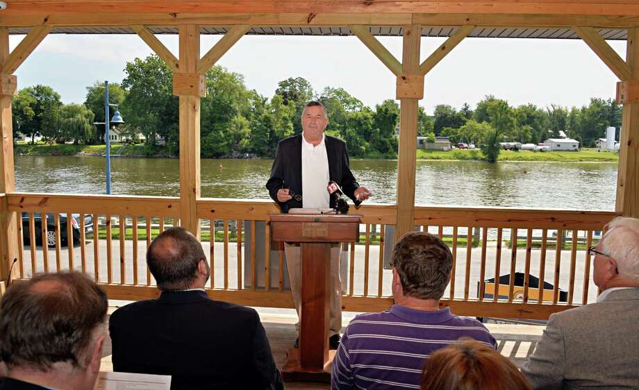 Mechanicville Supervisor Tom Richardson, center, speaks during a ribbon cutting ceremony to debut a new boathouse and improvements to Mechanicville's waterfront Friday, Aug. 8, 2014, in Mechanicville, N.Y.  (John Carl D'Annibale / Times Union) Photo: John Carl D'Annibale / 10028092A