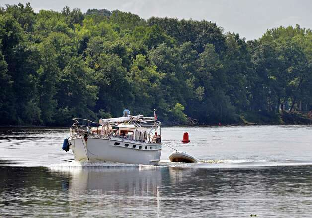 A yacht motors north past the Mechanicville waterfront Friday, Aug. 8, 2014, in Mechanicville, N.Y.  (John Carl D'Annibale / Times Union) Photo: John Carl D'Annibale / 10028092A