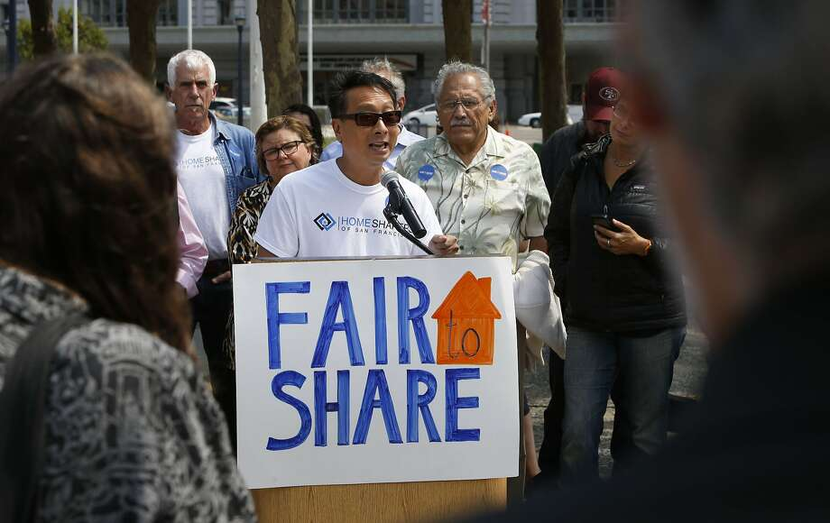 Peter Kwan, the organizer of Homeshares SF shows his support for the new Airbnb legislation as the San Francisco planning commission plans to discuss revisions to Supervisor David Chiu's proposed Airbnb legislation at their weekly meeting in City hall in on in August 2014. Photo: Michael Macor, The Chronicle