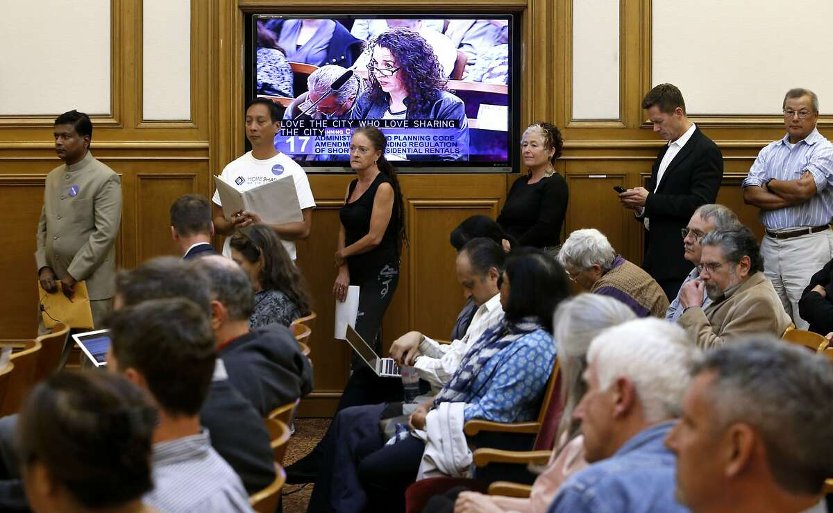 People line up for a chance to speak as the San Francisco planning commission hears public comment to Supervisor David Chiu's proposed Airbnb legislation at their weekly meeting in City Hall on Thursday August 7, 2014, in San Francisco, Calif.