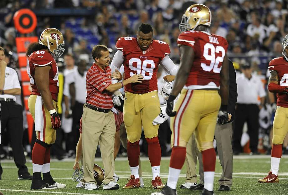 "Lawrence Okoye said Thursday his ankle injury was ""nothing serious."" Photo: Gail Burton, Associated Press"