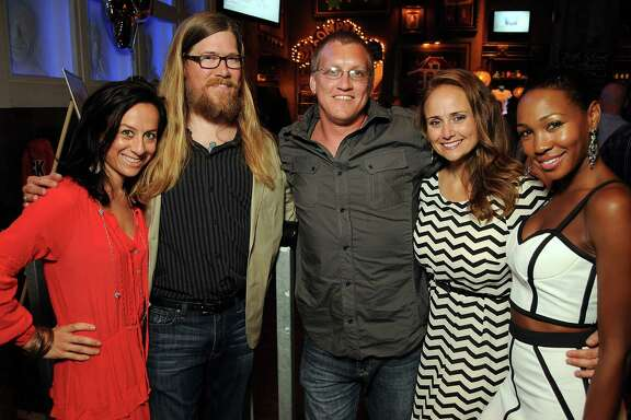 From left: Nichole Wright, Michael Brown, Jack Joffrion, Katie Rauscher and Teri Johnson at the Clear Lake High School Class of 1994 reunion at the House of Blues Saturday July 26, 2014.(Dave Rossman photo)