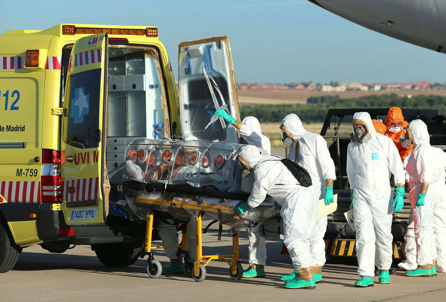 A Catholic priest who contracted the Ebola virus is transported from Madrid's Torrejon air base to a Spanish hospital. The Ebola outbreak in Africa has provoked widespread fear, but some of the American obsession with the disease is unnatural. Photo: AFP / Spanish Defense Ministry / Inaki Gomez / AFP