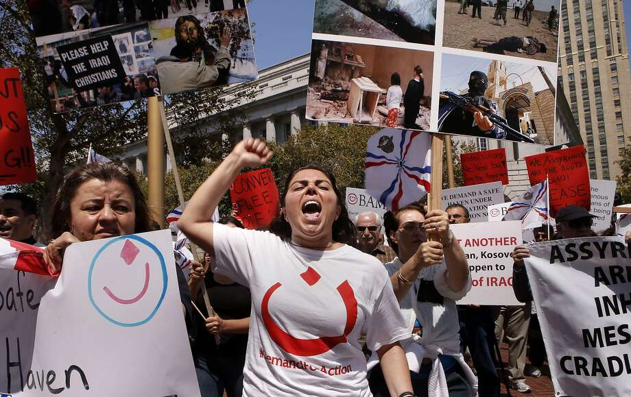 Eilona Betkolia of Campbell joins fellow Assyrian Christians from around the Bay Area hold a rally at United Nations Plaza in San Francisco, Calif., on Friday August 8, 2014, in of support fellow Christians who are suffering genocide at the hands of ISSI in Iraq. Photo: Michael Macor, The Chronicle