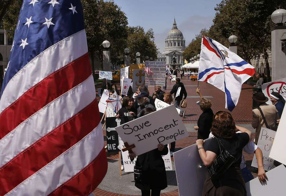 Assyrian Christians from around the Bay Area hold a rally at United Nations Plaza in San Francisco, Calif., on Friday August 8, 2014, in of support fellow Christians who are suffering genocide at the hands of ISSI in Iraq. Photo: Michael Macor, The Chronicle