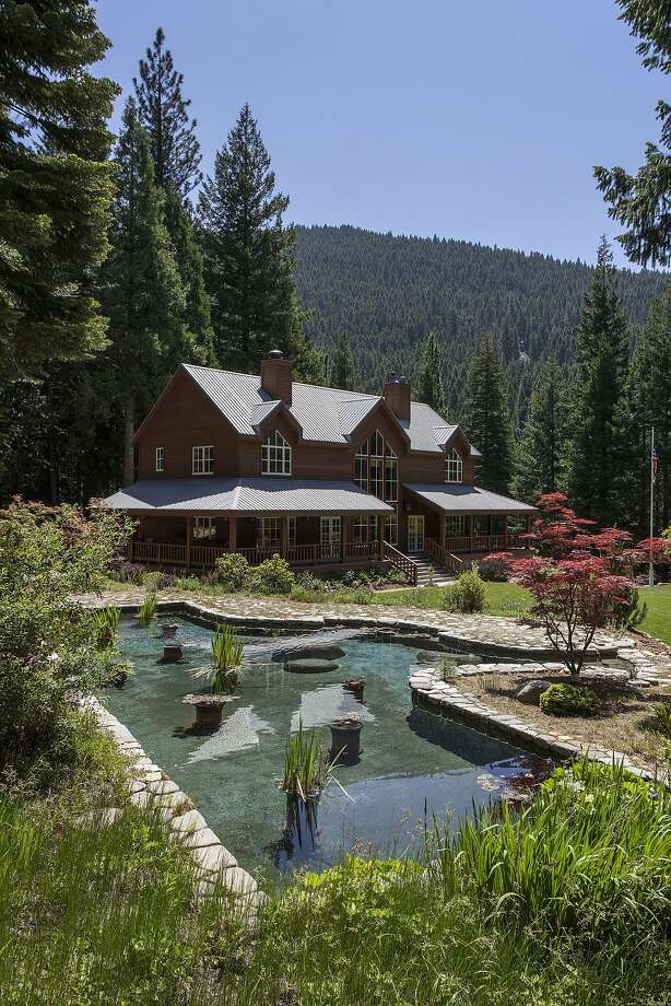 This Sierra City home at 32613 Highway 49 features a pond, artesian well, waterfalls and hiking trails within 118 acres of wooded landscape.