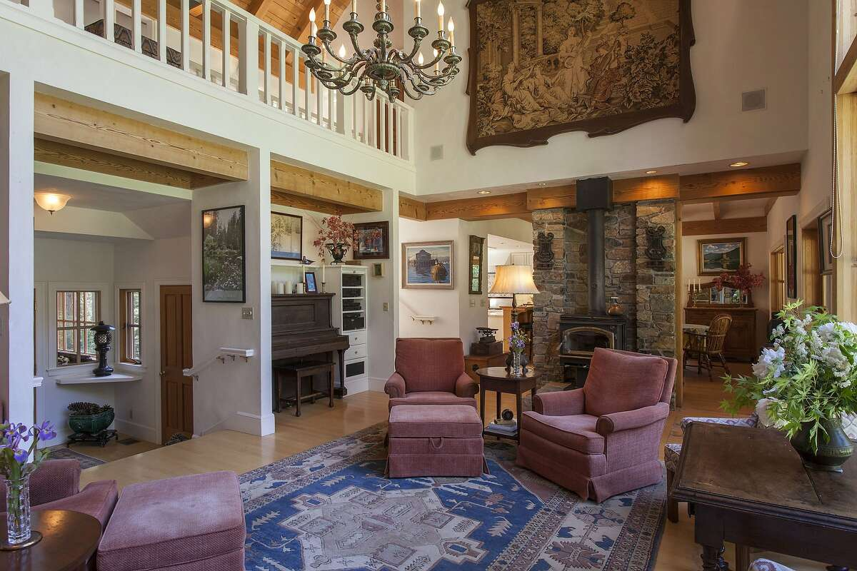 The living room features a stone fireplace and exposed trusses.Ê