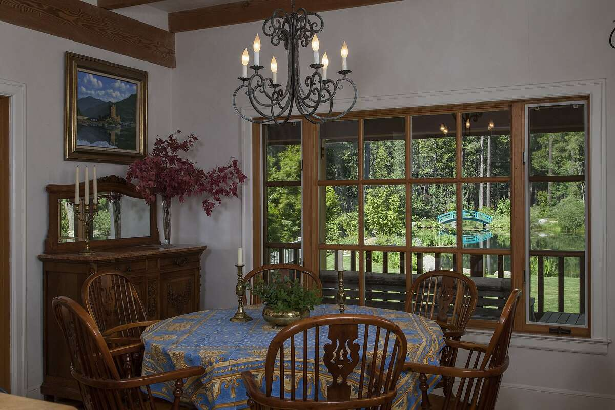 Divided light windows in the dining room look out at the deck and Monet's bridge.Ê