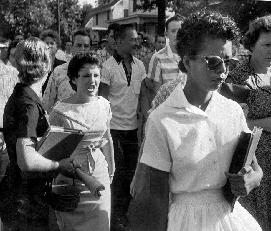 Hazel Bryan (center) and other students at Central High School in Little Rock, Ark., heckle Elizabeth Eckford as she walks by Sept. 4, 1957. Bryan later apologized to Eckford. Photo: Arkansas Democrat Gazette File Photo / ARKANSAS DEMOCRAT GAZETTE