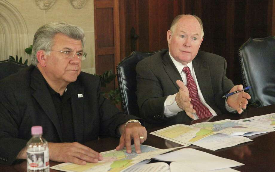 Chairman of the San Antonio Water System board Berto Guerra (left) and SAWS trustee Reed Williams are leading negotiations to secure a water pipeline deal that will greatly enhance the city's future water supply. Photo: Juanito M. Garza / San Antonio Express-News / San Antonio Express-News