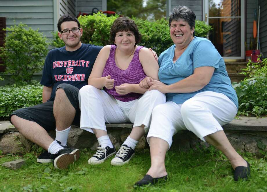 Arlene Litt, right, poses with her children Jacob, 18, and Rachel, 16, outside their home in Ridgefield. Rachel is autistic and the family is one of more than 300 in Connecticut who face a lengthy waiting period to get services from the state Department of Developmental Services. Photo: Tyler Sizemore / The News-Times