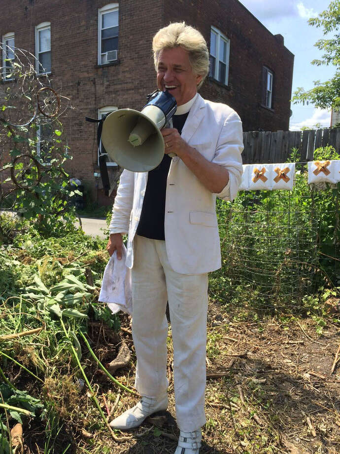 Reverend Billy in Troy on July 18 when he and the Stop Shopping Choir participated in a blessing of the bees that had been transported from a hive at the Contemporary Artists  Center at the historic Woodside Church in South Troy across the city the bees' new home in a perennial garden set up by the Sanctuary for Independent Media. (Courtesy Sanctuary for Independent Media)