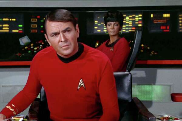 """LOS ANGELES - JANUARY 12: James Doohan as Montgomery """"Scotty"""" Scott on the bridge with Nichelle Nichols as Uhura in the STAR TREK episode, """"A Piece of the Action."""" Original air date, January 12, 1968, season 2, episode 17. Image is a screen grab."""