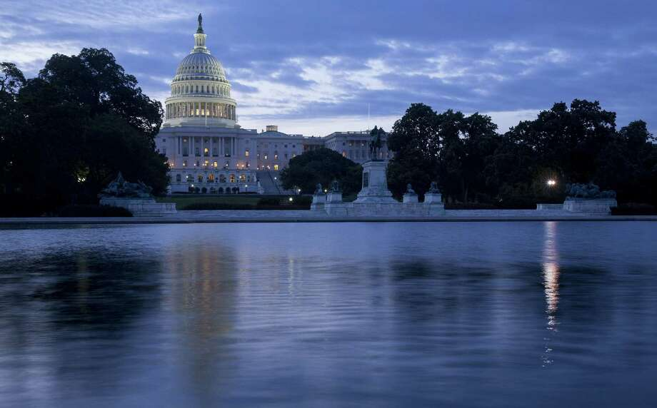 With Congress on break the U.S. Capitol Building is all but empty. A reader says it seems as if Congress is always on vacation, since officials can't get anything done. Photo: Andrew Harrer, Bloomberg / © 2014 Bloomberg Finance LP