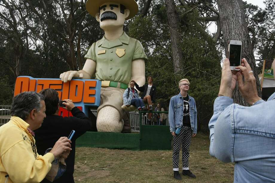 Outside Land attendees get their photo taken with Ranger Dave in Golden Gate Park on Friday, Aug. 8, 2014 in San Francisco, Calif. Outside Lands is expected to draw in as many as 180,000 people this weekend. Photo: James Tensuan, The Chronicle