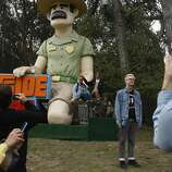 Outside Land attendees get their photo taken with Ranger Dave in Golden Gate Park on Friday, Aug. 8, 2014 in San Francisco, Calif. Outside Lands is expected to draw in as many as 180,000 people this weekend.