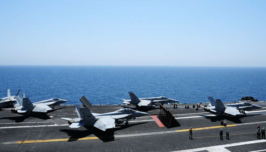 This image released by the U.S. Navy shows sailors launching aircraft from the aircraft carrier USS George H.W. Bush (CVN 77) on Thursday, Aug. 7, 2014 in the Persian Gulf. George H.W. Bush is supporting maritime security operations and theater security cooperation efforts in the U.S. 5th Fleet area of responsibility. (AP Photo/U.S. Navy, Margaret Keith) Photo: MC2 Joshua Horton, Associated Press
