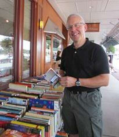 For 21 years, Bob Meyer has been volunteering to sell books and music at the Book House of Stuyvesant Plaza during the plaza?s sidewalk sale, which was most recently presented on Saturday, Aug. 2.  ?Help Fight AIDS Through Books and Music,? is a volunteer project for the AIDS Council of Northeastern NY.(Submitted photo)