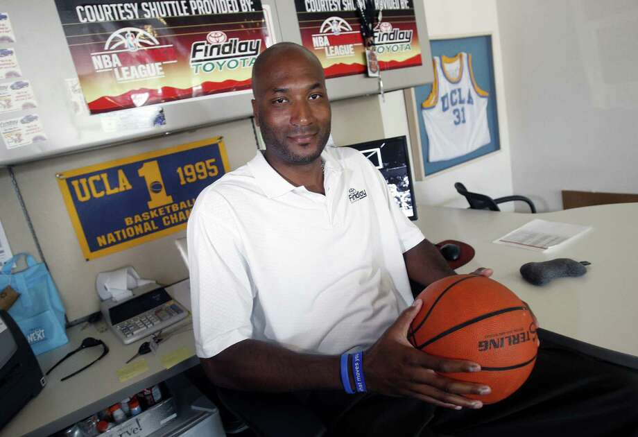 FILE - In this Sept. 18, 2010, file photo, former UCLA basketball player Ed O'Bannon Jr. sits in his office in Henderson, Nev. A federal judge ruled Friday, Aug. 8, 2014 that the NCAA can't stop college football and basketball players from selling the rights to their names and likenesses, opening the way to athletes getting payouts once their college careers are over. Photo: Isaac Brekken, AP / FR159466 AP