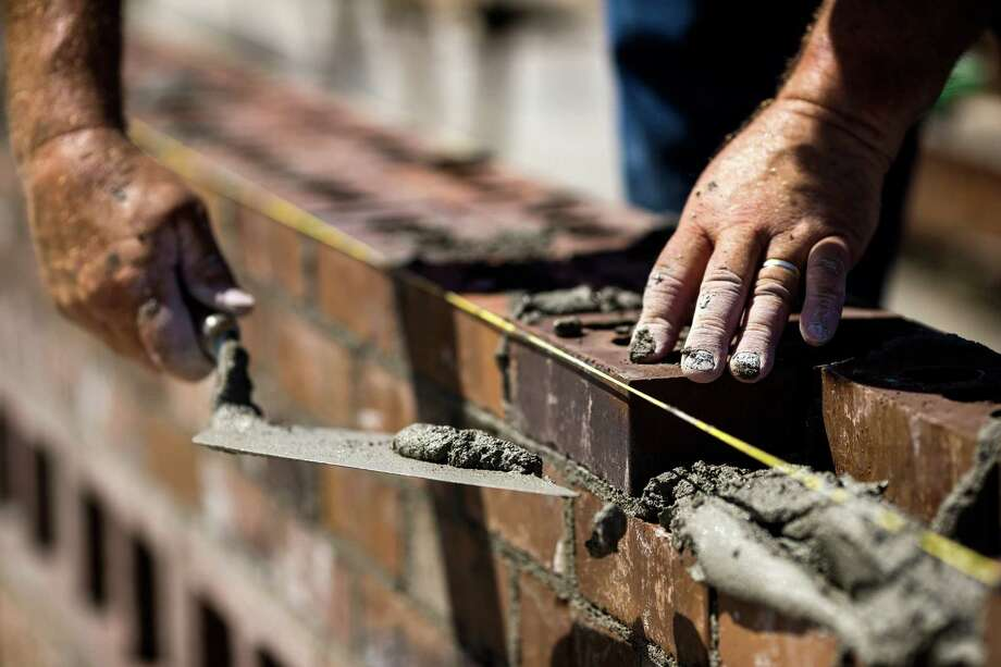 "Pitted against opposing teams, skilled masons and their assistants - known as ""tenders"" - race against the clock to stack up organized walls of bricks at the fifth annual World Series of Bricklaying Friday, August 8, 2014, in Seattle, Wash. Craftsmen representing the state of Washington competed for cash and the opportunity to advance to the National Championship competition held next year in Las Vegas. Photo: JORDAN STEAD, SEATTLEPI.COM / SEATTLEPI.COM"
