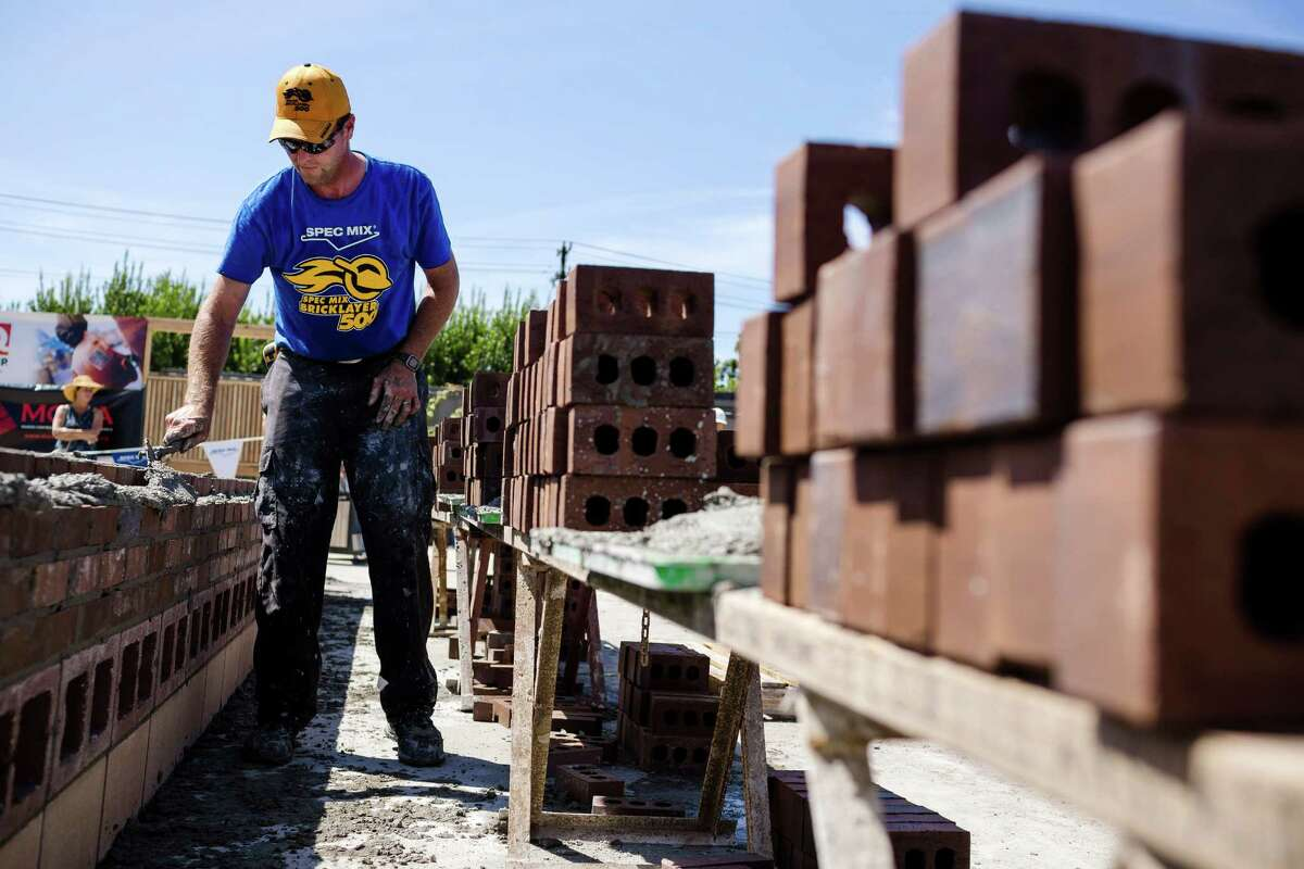 Jason Larimore, of Fairweather Masonry, races against the clock to stack up organized walls of bricks at the fifth annual World Series of Bricklaying Friday, August 8, 2014, in Seattle, Wash. Craftsmen representing the state of Washington competed for cash and the opportunity to advance to the National Championship competition held next year in Las Vegas.