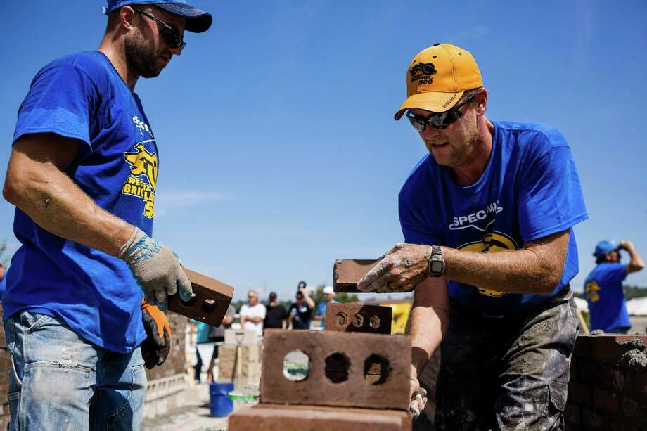 Jason Larimore, right, of Fairweather Masonry, races against the clock to stack up organized walls of bricks at the fifth annual World Series of Bricklaying Friday, August 8, 2014, in Seattle, Wash. Craftsmen representing the state of Washington competed for cash and the opportunity to advance to the National Championship competition held next year in Las Vegas. Photo: JORDAN STEAD, SEATTLEPI.COM / SEATTLEPI.COM
