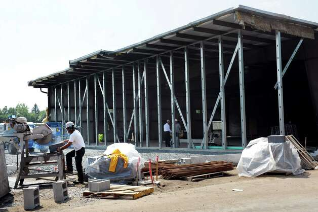 A new showroom is under construction on Tuesday, Aug. 5, 2014, at Goldstein Subaru in Colonie, N.Y. (Cindy Schultz / Times Union) Photo: Cindy Schultz / 00028047A