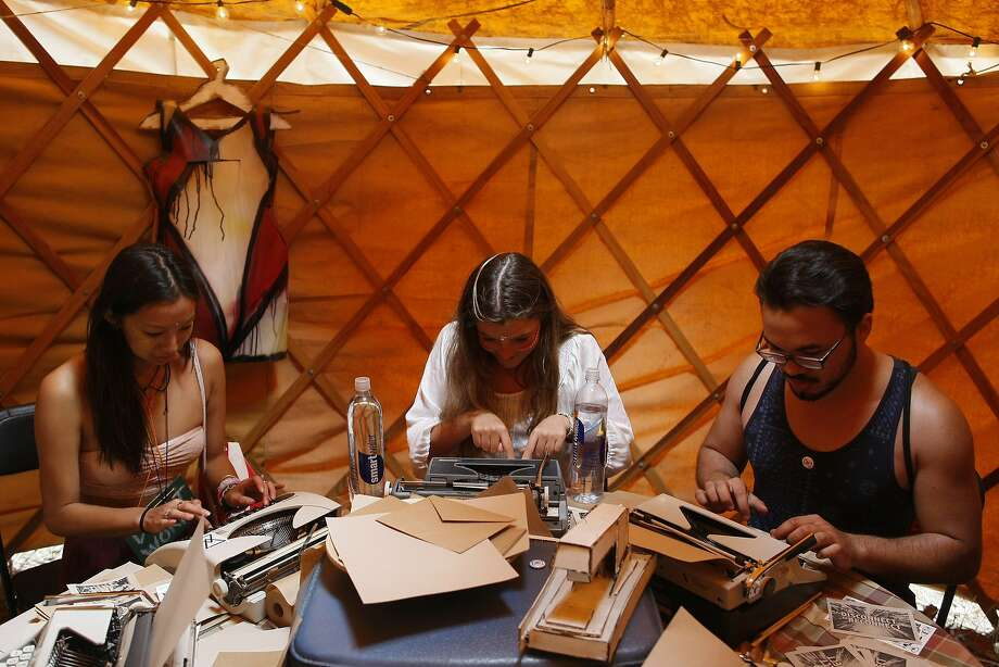 Maddie Porsnick, center, types a letter on a typewriter at the digital detox section of Outside Lands on Friday, Aug. 8, 2014 in San Francisco, Calif. Outside Lands is expected to draw in as many as 180,000 people this weekend. Photo: James Tensuan, The Chronicle