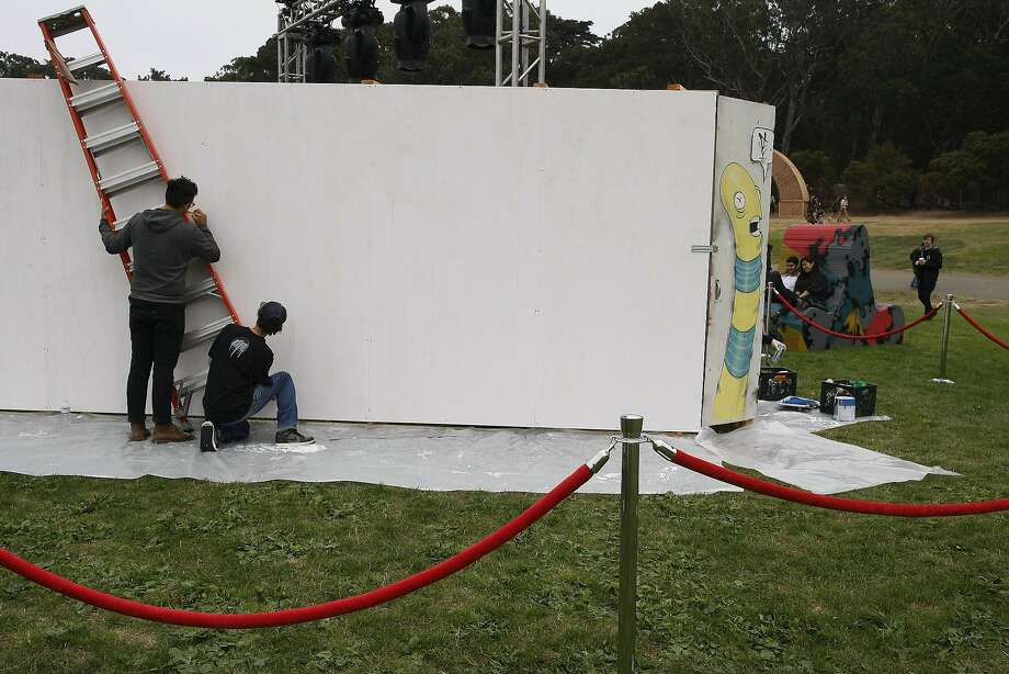 Steve Six, left, and Sage Stuart sketch out a mural at Outside Lands on Friday, Aug. 8, 2014 in San Francisco, Calif. Outside Lands is expected to draw in as many as 180,000 people this weekend. Photo: James Tensuan, The Chronicle