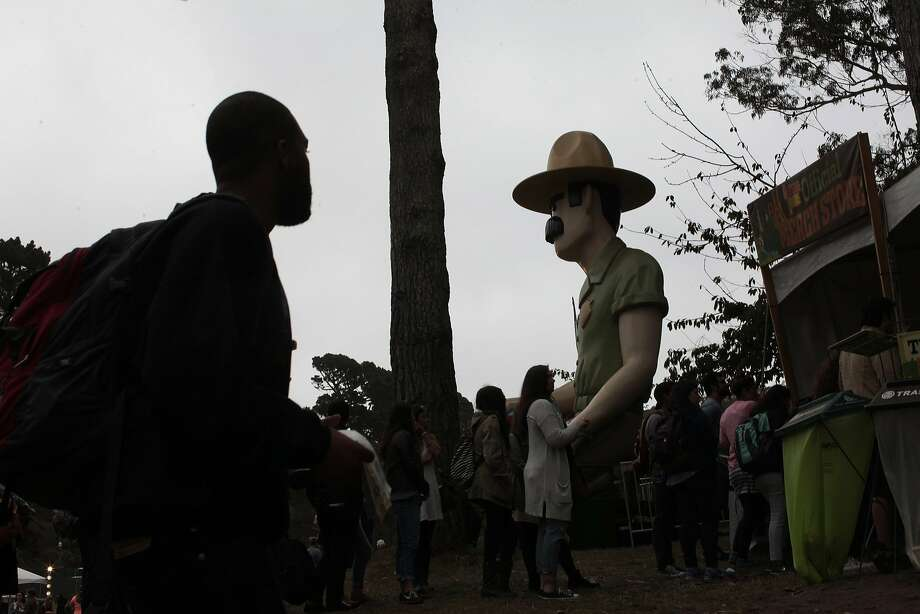 An Outside Land attendee passes Ranger Dave on his way into the music festival on Friday, Aug. 8, 2014 in San Francisco, Calif. Outside Lands is expected to draw in as many as 180,000 people this weekend. Photo: James Tensuan, The Chronicle