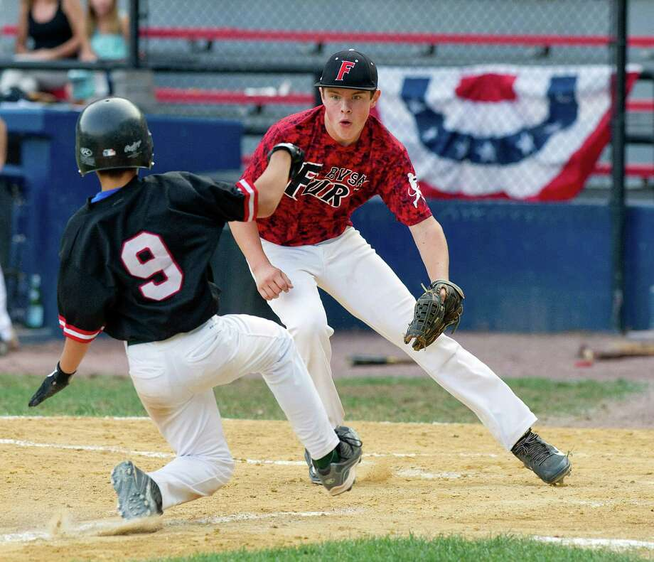 Bobby Valentine's Sports Academy Fury's Jackson Yancy gets Greenwich's Luca Grandinetti out at home plate during Friday's Sharkey Laureno Tournament, 14-year-old division, game at Scalzi Park in Stamford, Conn., on August 8, 2014. Photo: Lindsay Perry / Stamford Advocate