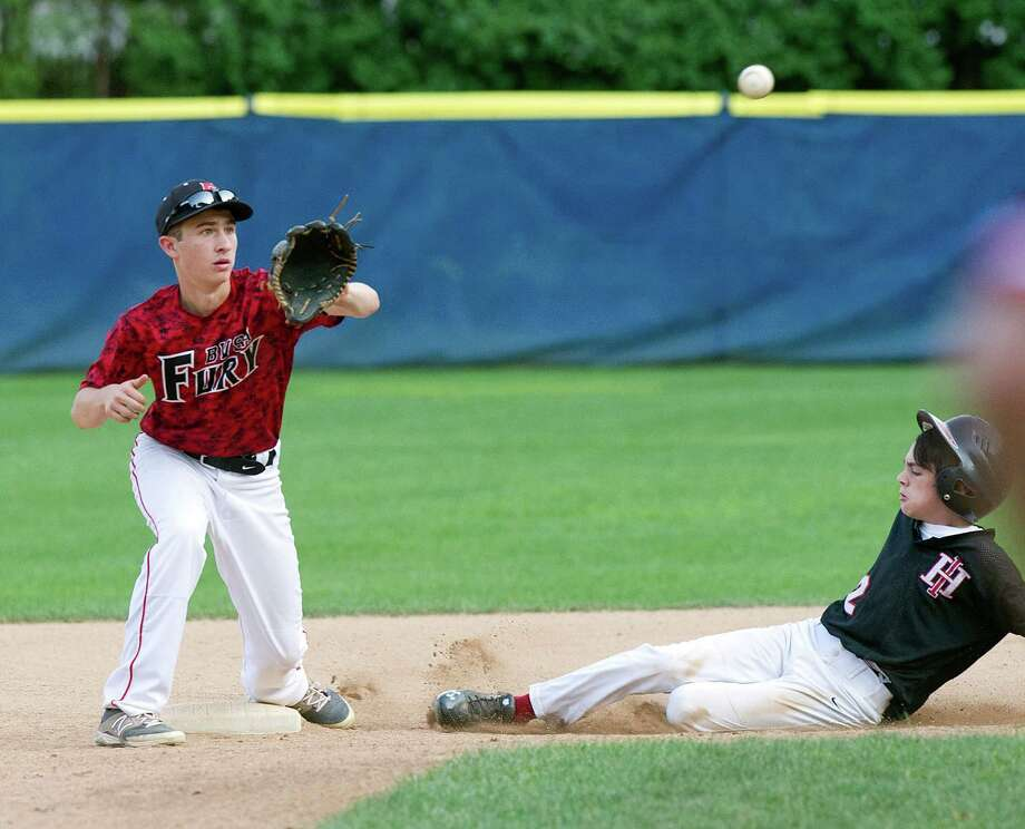 Greenwich's Charlie Zeeve slides safely into second base as Bobby Valentine's Sports Academy Fury baseman Jason Trumpor reaches for the ball during Friday's Sharkey Laureno Tournament, 14-year-old division, game at Scalzi Park in Stamford, Conn., on August 8, 2014. Photo: Lindsay Perry / Stamford Advocate